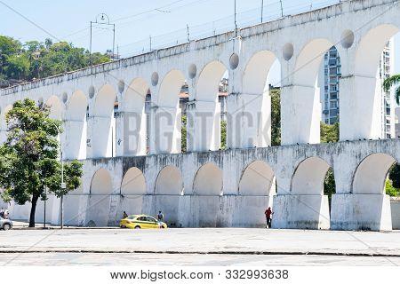 Rio De Janeiro, Brazil- October 13, 2019: Carioca Aqueduct, Also Known As Arcos Da Lapa In Historic