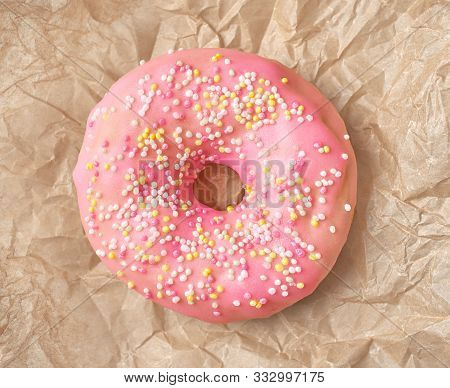 Freshly Baked Donut On Crumpled Wrapping Paper Background, Top View