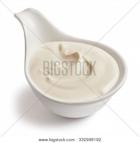 Bowl Of Sour Cream Isolated On White Background