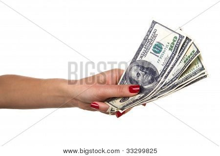 Woman hand with red nails offers dollars