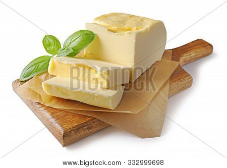 Piece Of Butter On Wooden Cutting Board Isolated On White Background