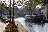 View on a historical barge and footbridge in nostalgia Schipluiden in the Netherlands poster