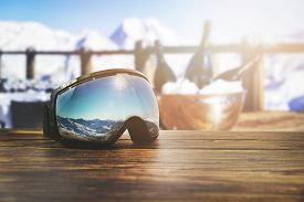 Apres Ski - Goggles With Mountains Reflection On The Restaurant Table At Ski Resort