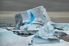 Unique iceberg with blue crack along the waters of the Antarctic Peninsula.