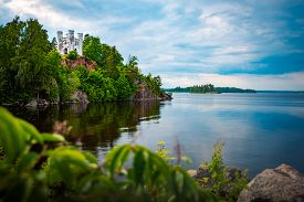 Old White House On Cliff Over Lake. Travel In Russia, Old Architecture.