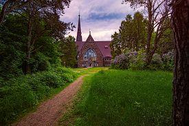 Old Finnish Church Koiviston Kirkko In Primorsk City Of Russia At Sunset. Travel In Europe.