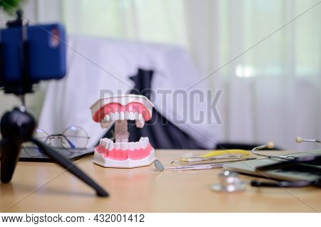 Teeth Model And Equipment For Dentist Working Online At Home. Recording Blog Video Dentistry.