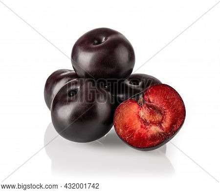 Heap Of Whole Black Plums And One Juicy Half Isolated On White Background. Fresh Ripe Sweet Plums Ar
