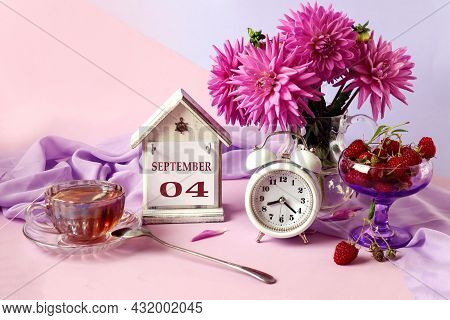 Calendar For September 4 : The Name Of The Month In English, Cubes With The Numbers 0 And 4, A Bouqu