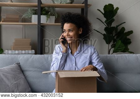 Young Black Lady Talk On Cell Unpack Parcel Container