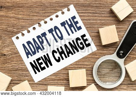 Adapt To The New Change, White Sheet Of Paper And Wood Planks On Wood Background