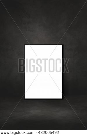 Blank Picture Frame Leaning On A Black Wall. Presentation Mockup Template