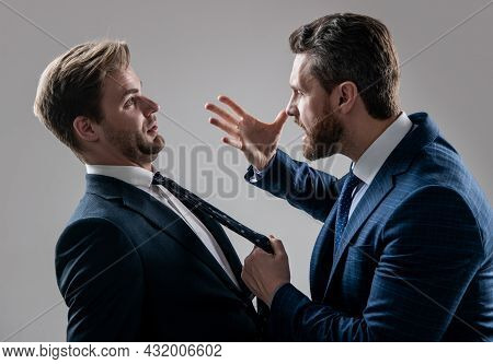 Two Angry Businessmen Fighting And Arguing Having Struggle For Leadership, Rivalry.