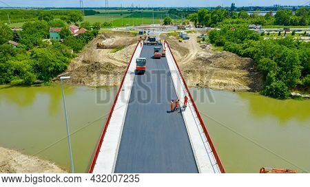 Above View, On Workers And Machinery For Laying Asphalt, Spreading Layer Of Hot Tarmac Over New Brid