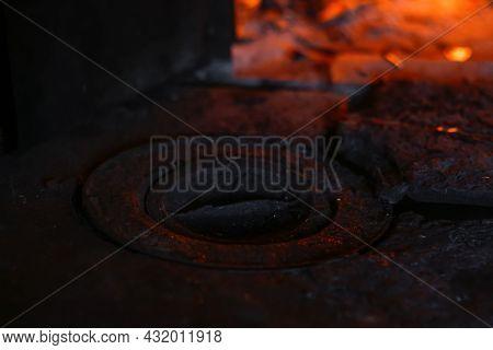 Defocus Wood Burning Stove. Iron Burner Close-up Antique. Firewood Burning In Old Stove Or Oven. Dar