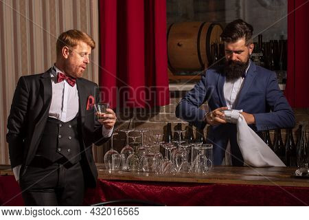 Bartender And Customer. Barman At Counter. Hipster In Bar. Old Traditional Whiskey Drink. Gentlemans