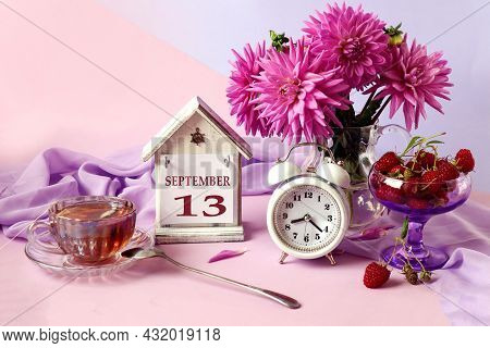 Calendar For September 13 : The Name Of The Month In English, Cubes With The Number 13, A Bouquet Of