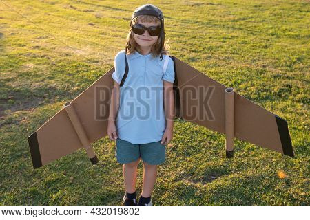 Child Boy Dreams And Travels. Boy With Airplane Toy Outdoors. Happy Child Playing With Toy Airplane