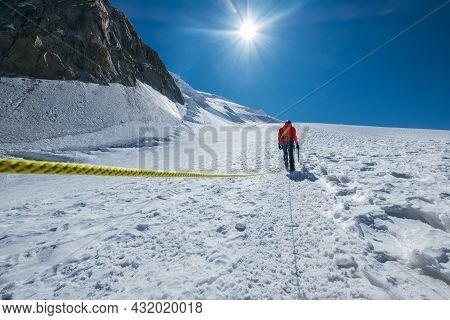 Woman Ascending Mont Blanc (monte Bianco) Summit 4,808m Dressed Red Mountaineering Clothes Walking B