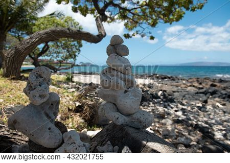 Stack Of Pebbles Stone Against Sea Background For Spa, Balance, Meditation And Zen Theme.