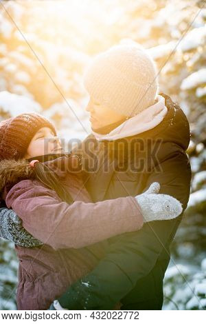 Family Winter Walk In The Forest. Raising A Child, Family Habits. Mother And Daughter Are Having Fun