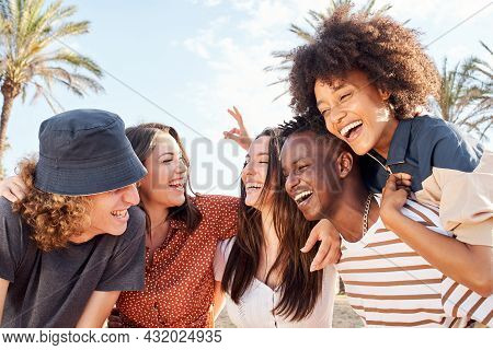 Group Of Young People Of Different Races Laughing And Having Fun Outdoors. Concept Of Vacation, Havi