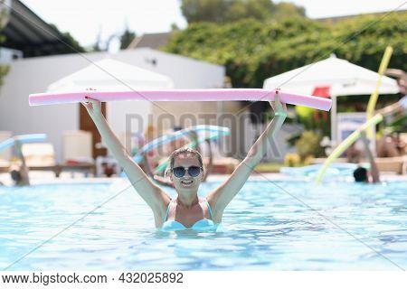 Aqua Aerobic Training With Water Fitness Equipment