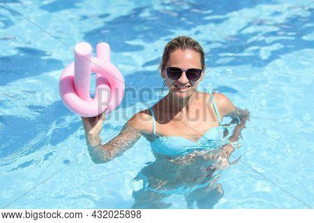 Smiling Young Woman In Swimsuit Doing Aqua Aerobics