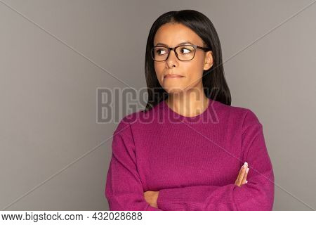 Puzzled And Confused African Woman Look Side At Copy Space Pensive Thinking Biting Lip. Young Mix Ra