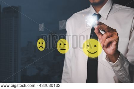 Businessman Hand With Pen Pressing Smiley Face Emoticon On Virtual Touch Screen.good Feedback Rating