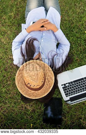 Woman Lay Down Sleep On Green Grass Meadow Garden Summer Sunshine Day Happy Time Outside. Hipster Fr