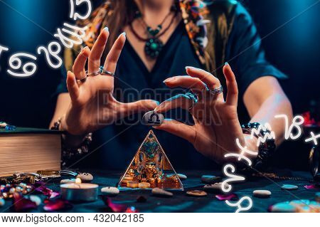 Astrology And Horoscope. A Witch Holds A Stone With The Sign Of The Zodiac Libra. Close Up. Zodiac C