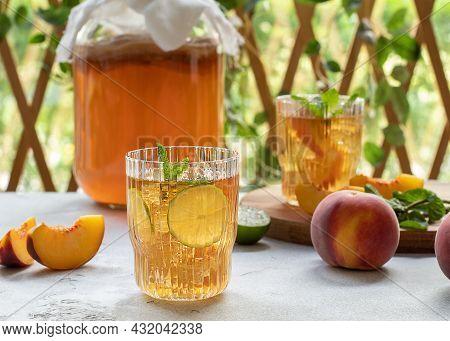 Kombucha Tea Slightly Alcoholic, Lightly Effervescent Drink With Peach And Lime. Homemade Fermentati
