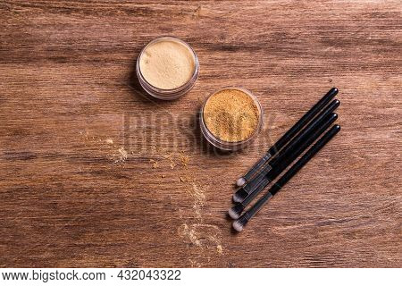 Loose Compact Mineral Powder For Face And A Brushes For Powder And Visage On Wooden Background. Eco
