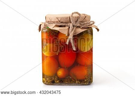 Preserved tomatos in glass jar. Isolated on white background