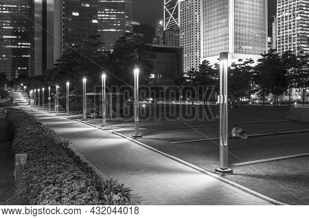 Promenade And Skyline Of Central District In Hong Kong City At Night