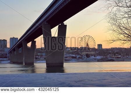 The World\'s Largest Metro Bridge Across The Ob River In The Morning Light, Snow On The Bank In Spri