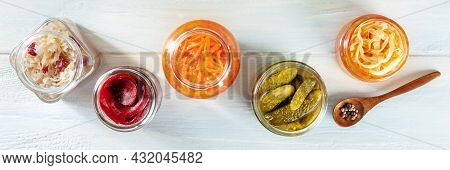 Fermented Food Panorama. Canned Vegetables. Pickles, Sour Cabbage And Other Organic Preserves In Gla