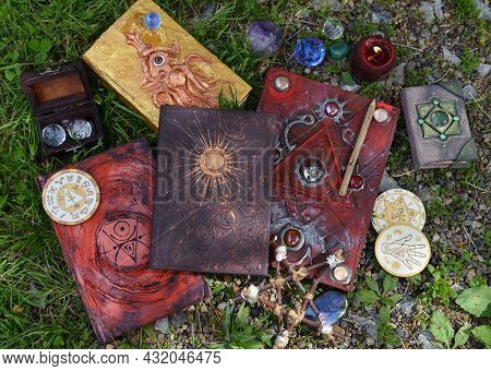 Pentagram, Magic Book Of Spells, Pentagram And Witch Objects On The Grass.  Esoteric, Gothic And Occ