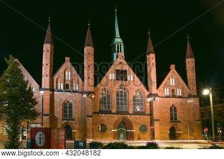 Heiligen Geist Hospital (holy Spirit Hospital) In Lubeck At Night, One Of The Oldest Existing Social