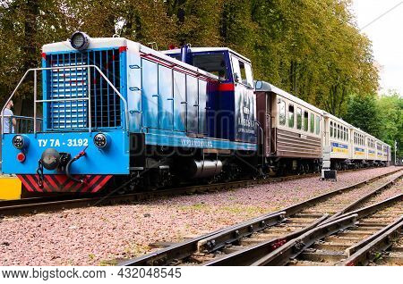 Kyiv, Ukraine-august 22, 2021:scenic View Of Vintage Locomotive Tu7a With Several Passenger Cars At