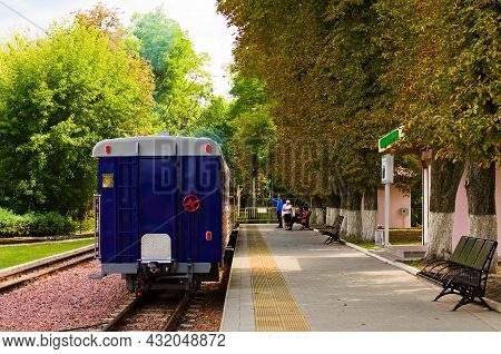 Kyiv, Ukraine-august 22, 2021:children's Train Departs From The Station. The Stationmaster Allowed T
