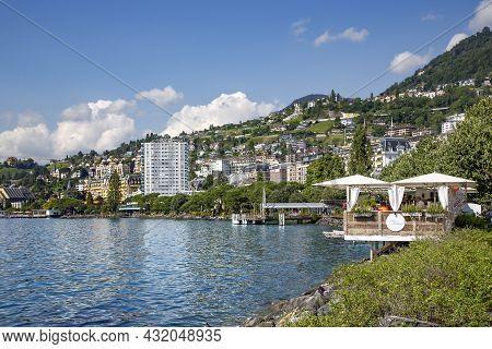 Switzerland, Montreux, August 2021 - Geneva Lake With Open Verandas Of Restaurants And The Popular P
