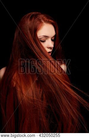 Redhead Girl With Long Hair Contrast Art Portrait. Perfect Woman On Black Background. Gorgeous Hair