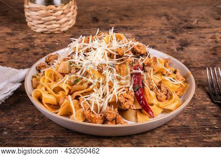 American-italian Pasta Fettuccine With Sausage Ragout With Hot Pepper, Portion In A Plate, Close-up