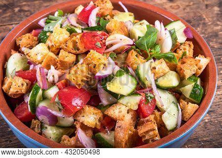 Tuscan Vegetarian Panzanella Salad In A Bowl, Close-up Of Italian Rustic Cuisine.
