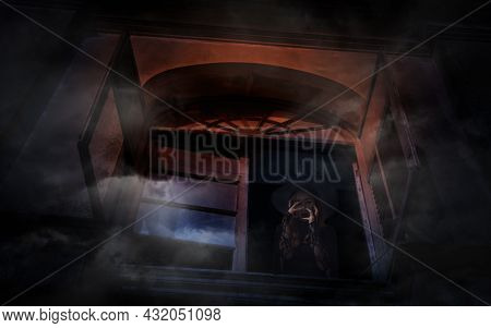 Scary Halloween Witch Standing In Old Ancient Window Castle, Halloween Mystery Concept