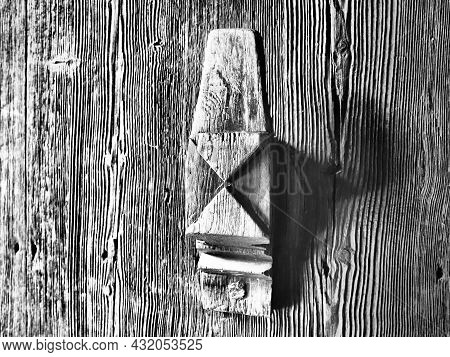 Old Carved Wooden Doorknob. A Traditional Rustic Pattern Or Ornament Carved With A Knife On A Wood S