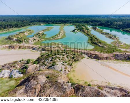 Colored Lakes And Old Waste Rock Dumps On The Site Of The Abandoned Ilmenite Quarry Against The Fore