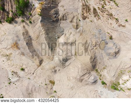 Old Colored Waste Rock Dumps Of Abandoned Quarry For The Extraction Of Ilmenite Ore, Vertical Aerial